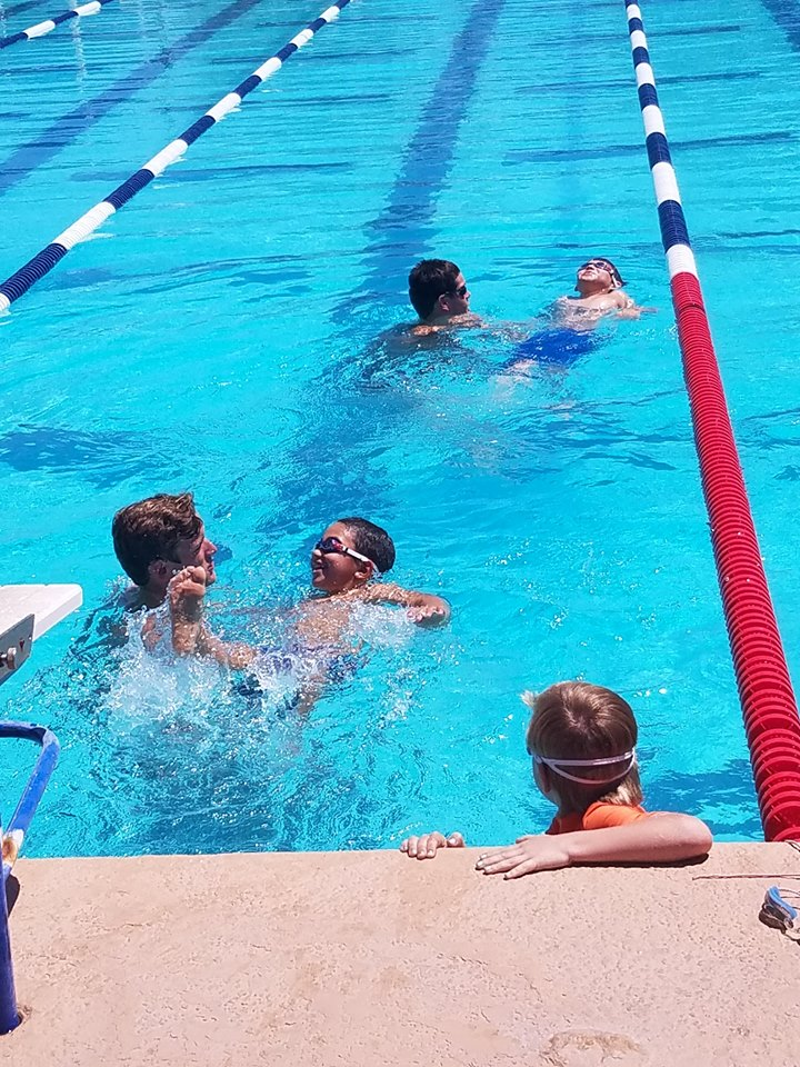 Members of the University of Arizona swim team volunteered to help teach kids basic swimming techniques. Photo courtesy Primavera Foundation